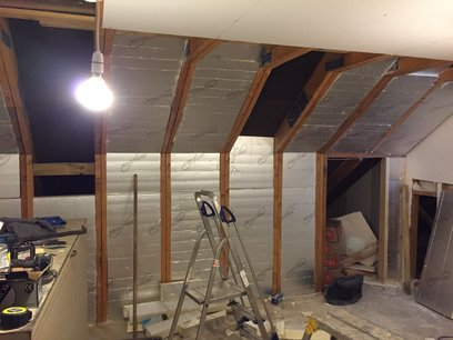 Loft installation of solid insulation between rafters and ceiling, new wiring for sockets and lights installed. MJS Building Maintenance Ltd.