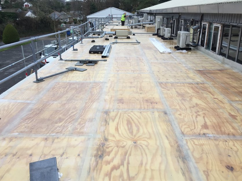 340m2 roof fiber-glassed and water tight in three weeks.   the Gel coat was later applied in sections to allow for moving around air units and other obstacles on the roof.  This was a very challenging project and by far not easy to complete with weather conditions and restriction on site, however the customer was happy the factory could continue throughout the working process. All work carried out by MJS Building Maintenance LTD.