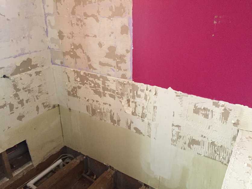 Old Bathroom wall coverings and tiles removed back to original surface.