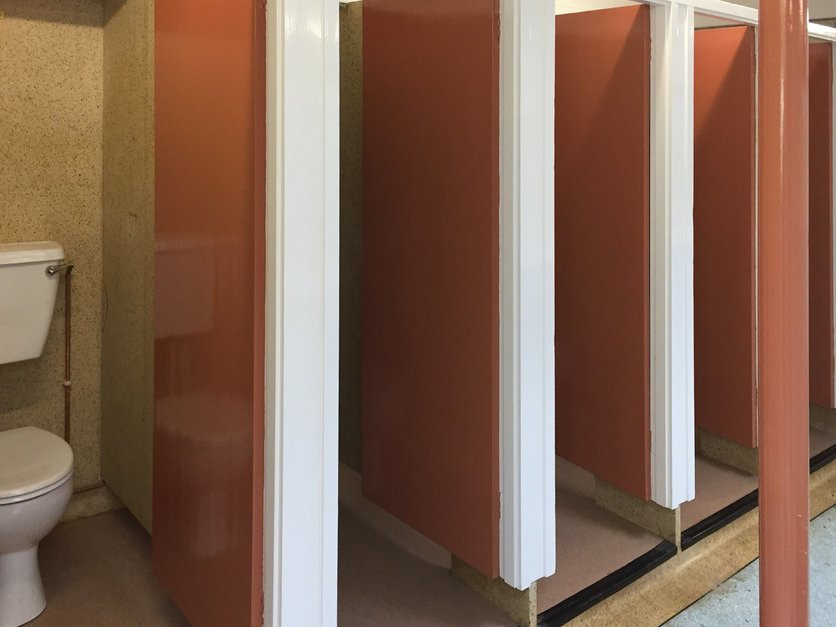 Campsite shower block, all woodwork was decorated, (colour chosen by client) wood work was rubbed down and given a coat of primer and two coats of high gloss in North Devon
