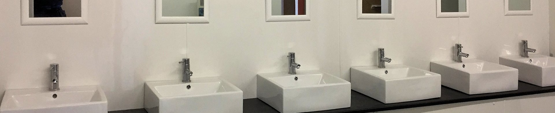 Camp site shower block with belfast sinks in bathroom installations