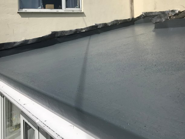 GRP fiberglass roof top coated with gel and non slip grit, ready for the lead flashings to be redressed.