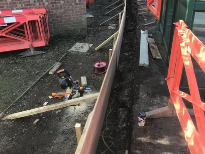 Installation of shuttering form work for concrete ring beam.