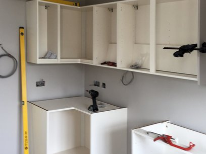 Kitchen units being fitted in North Devon