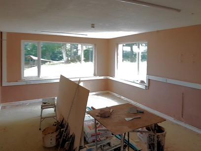 Two coats of plastering being applied.