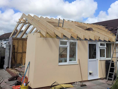 Roof trusses installed, trimmed for velux windows, braces installed.