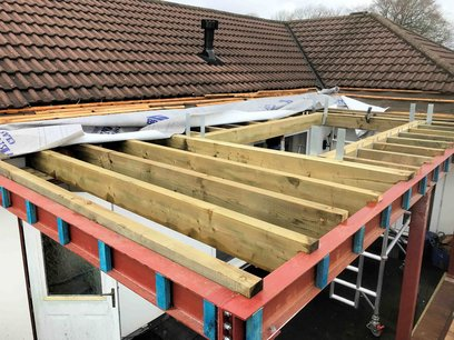 Construction of summer room on the first floor North Devon, joists installed at 400 centres, apertures created and fitted on joist hangers.