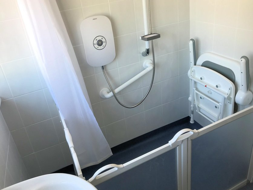 Adaption suit installed including easy use shower support handles gate access and fold down seat and shower curtain