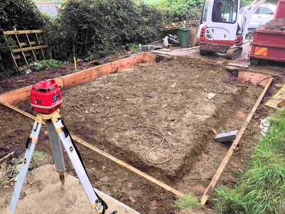 Old garage removed, site leveled graded and hardcore layed. External shuttering installed using laser level. Barnstaple North Devon