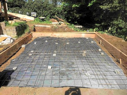 Garage foundation preparation, Visqueen damp proof membrane layed on sand bed. Concrete mesh installed and tied to form full sized sheet. North Devon