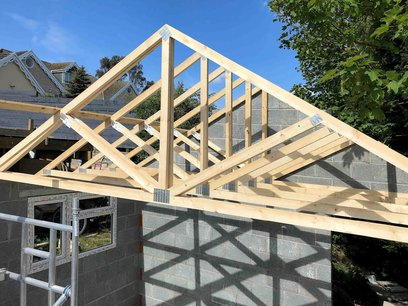 Garage roof trusses in place, cross braces installed. North Devon