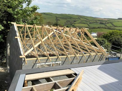 Garage roof trusses installed, first gable end build to full hight. North Devon