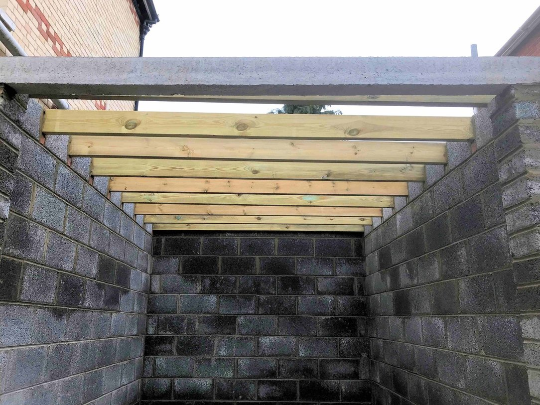Part of Garage construction , the concrete door lintel and roof joists installed in Barnstaple.