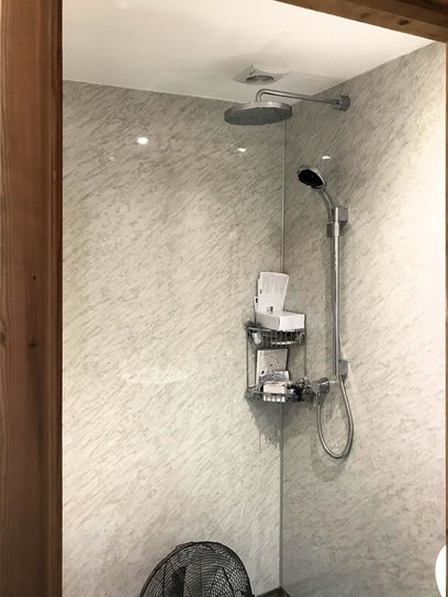 Bluetooth wireless digital controlled shower fitted with hose and round fixed chrome drencher head. Barnstaple North Devon
