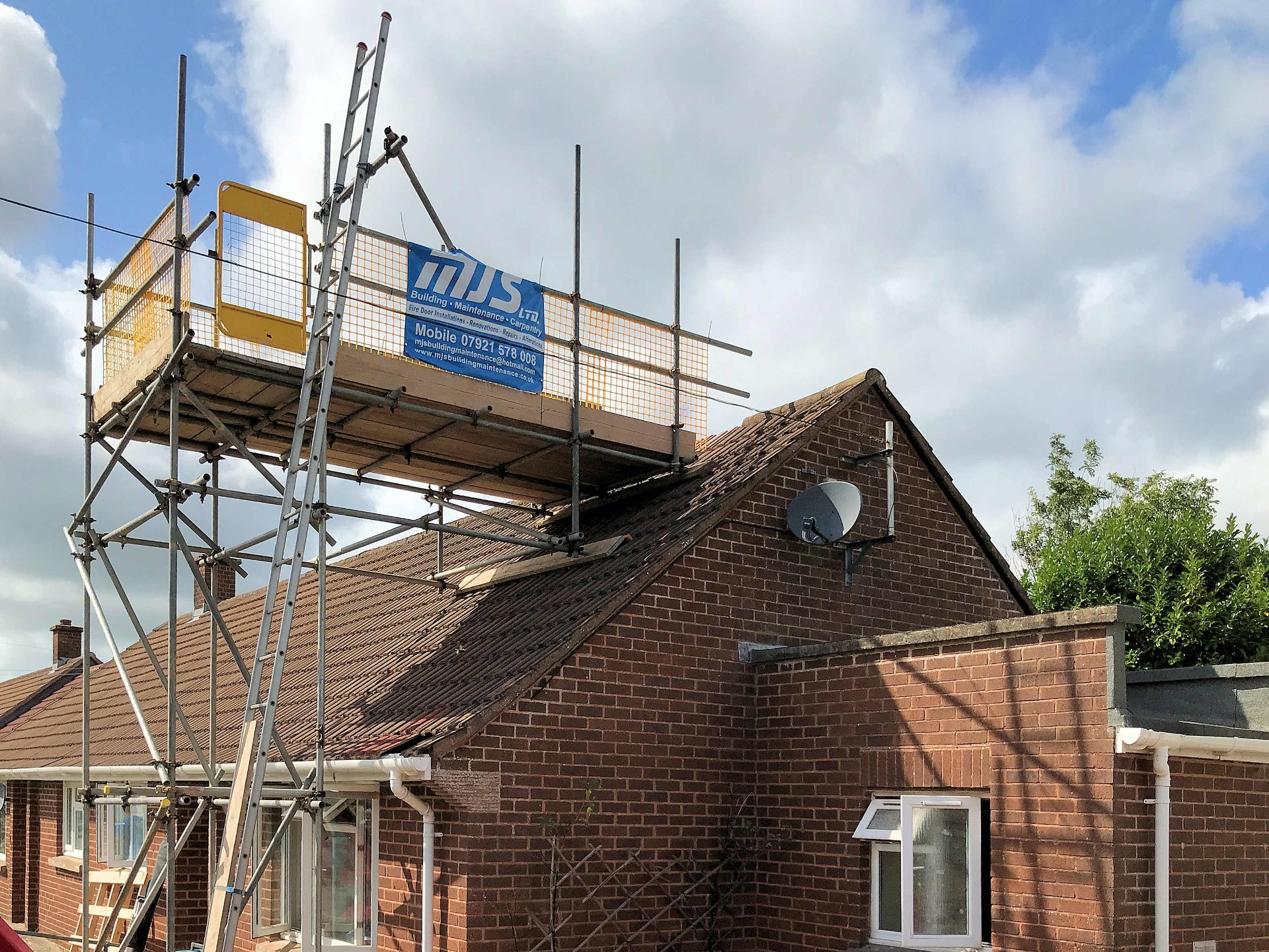Scaffold erected to enable removal of complete chimney and subsequent repairs to roof. North Devon