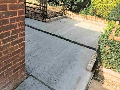 New concrete level hard standing completed to enable access to the garden for wheelchair users. North Devon