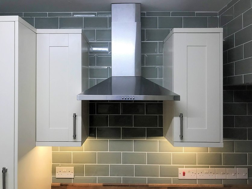 Cooker hood extractor fan with wall hung cabinet units and led lighting installation. Barnstaple North Devon