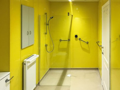 Custom bright yellow wet room North Devon