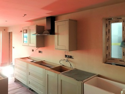 Kitchen with Island, Cooker hood extractor installed and unit doors. Barnstaple North Devon