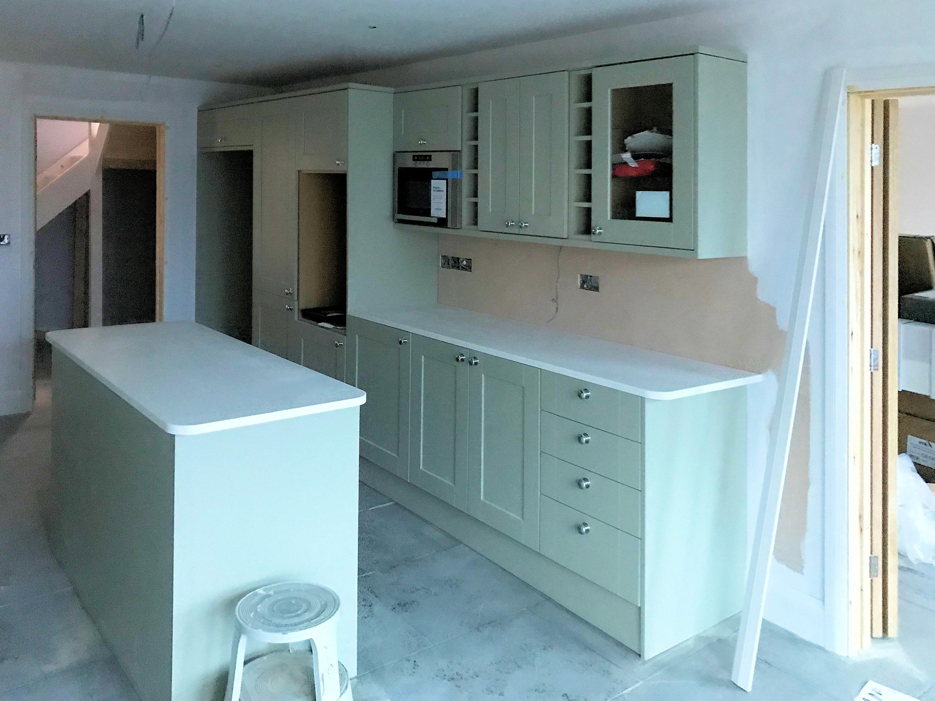 Kitchen with Island, all acrylic worktop edges routered off and rounded and polished