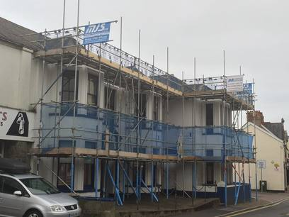 Installation of scaffolding ready for the decoration and roofing works.