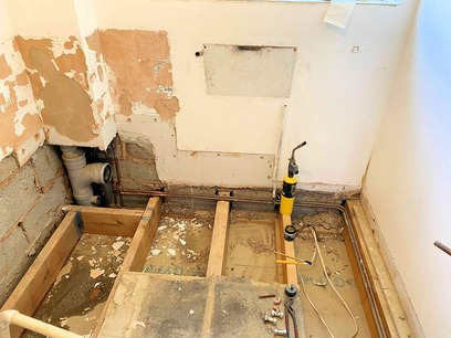 Bathroom to Wet Room; Remove suite and the water damaged floor. Barnstaple North Devon