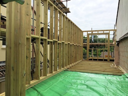 Framing out of timber stud walls, forming window openings and timber lintels, part of house extension in Barnstaple North Devon