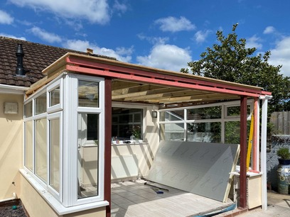 Install insulation to underside of new fibreglass roof Conservatory. Barnstaple North Devon