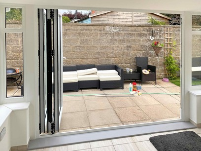 Three door bifold doors opened to one side. Conservatory. Barnstaple North Devon
